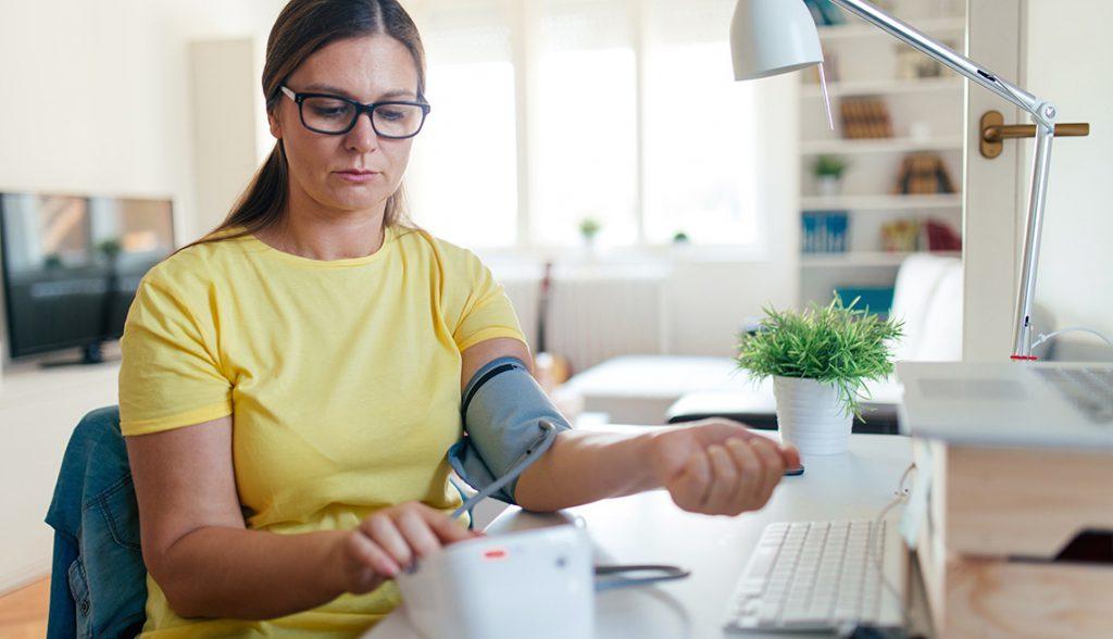 Woman checking blood presure