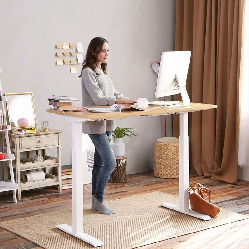 girl working on a standing desk at home