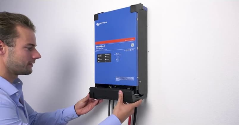 man standing in front of the solar inverter charger