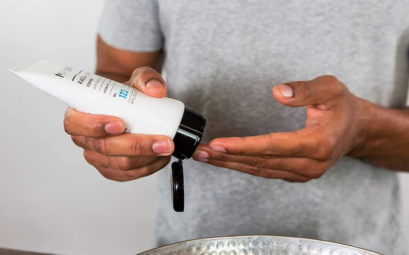 man-using-skincare-product