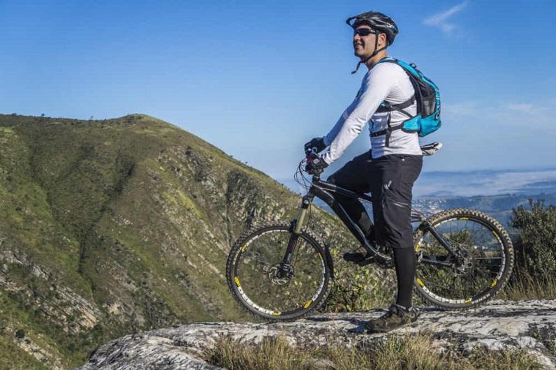 a male mountain biking