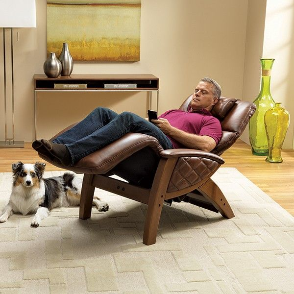 man sleeping on a human touch chair